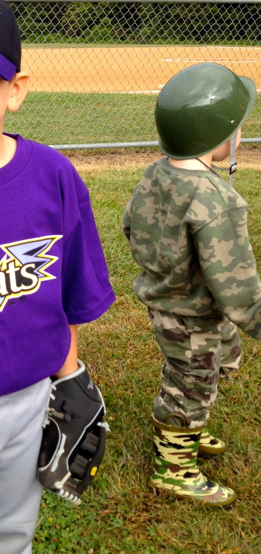 My grandson, the protector at T-ball
