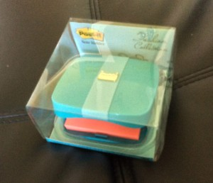 Woman's compact with pad of adhesive notes